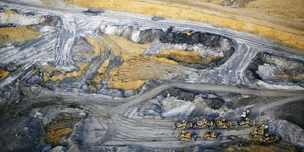 Bulldozers sit in this aerial photograph taken above the Peabody Energy Corp. Wild Boar coal mine in Lynnville, Indiana, U.S., on Tuesday, April 5, 2016. Peabody filed for bankruptcy on Wednesday, the most powerful convulsion yet in an industry that's still waiting for the coal market to bottom out. Photographer: Luke Sharrett/Bloomberg via Getty Images