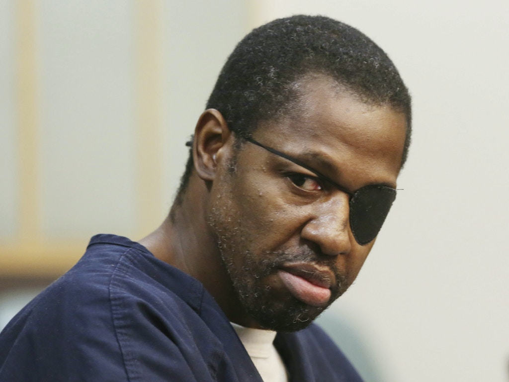 FILE- In this Feb. 22, 2017 file photo, accused murderer Markeith Loyd looks toward family members during court proceedings in Orlando, Fla. State Attorney Aramis Ayala said, Thursday, March 16, 2017, that she had decided to no longer seek the death penalty in first-degree murder cases after conducting a review. The most visible case immediately affected by Ayala's decision is that of  Loyd, who is charged with killing his pregnant ex-girlfriend and Orlando Police Lt. Debra Clayton. (Red Huber /Orlando Sentinel via AP, File)
