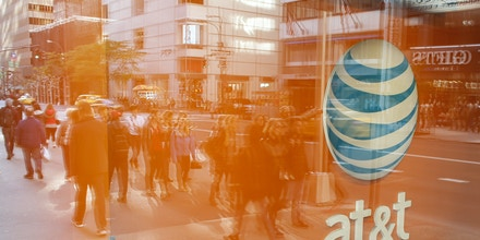 An AT&T store is seen on 5th Avenue in New York on October 23, 2016. AT&T unveiled a mega-deal for Time Warner that would transform the telecom giant into a media-entertainment powerhouse positioned for a sector facing major technology changes. The stock-and-cash deal is valued at $108.7 billion including debt, and gives a value of $84.5 billion to Time Warner -- a major name in the sector that includes the Warner Bros. studios in Hollywood and an array of TV assets such as HBO and CNN. / AFP / KENA BETANCUR (Photo credit should read KENA BETANCUR/AFP/Getty Images)