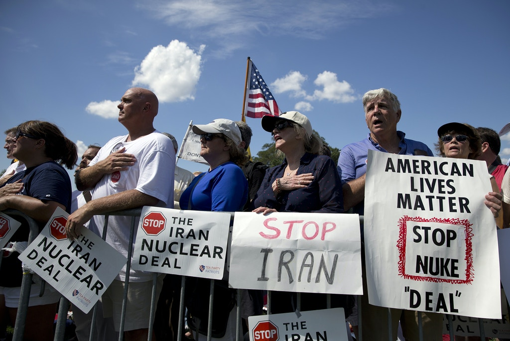 People in the crowd stand for the Pledge of Allegiance at a rally organized by Tea Party Patriots in on Capitol Hill in Washington, Wednesday, Sept. 9, 2015, to oppose the Iran nuclear agreement. (AP Photo/Carolyn Kaster)