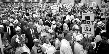A spectators' section of Atlantic City, N.J.'s vast Convention Hall is jammed with senior citizens hours before the third session of the Democratic National Convention was due to start, Aug. 26, 1964.  They are supporting the Medicare program Pres. Johnson is trying to get through Congress.   (AP Photo)