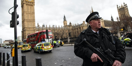 LONDON, ENGLAND - MARCH 22: An armed police officer stands guard near Westminster Bridge and the Houses of Parliament on March 22, 2017 in London, England. A police officer has been stabbed near to the British Parliament and the alleged assailant shot by armed police. Scotland Yard report they have been called to an incident on Westminster Bridge where several people have been injured by a car. (Photo by Jack Taylor/Getty Images)