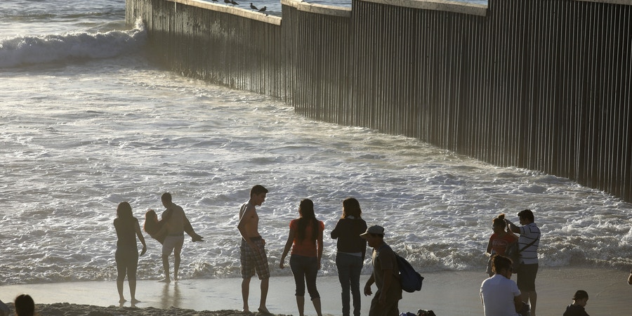 TIJUANA, MEXICO - SEPTEMBER 25: People enjoy a late afternoon near the U.S.-Mexico border fence which ends in the Pacific Ocean on September 25, 2016 in Tijuana, Mexico. Friendship Park, located on the border between the two countries is one of the few places on the 2,000-mile border where separated families are allowed to meet. (Photo by John Moore/Getty Images)