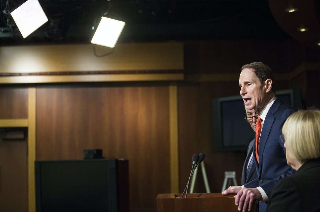 Sen. Ron Wyden, D-Ore., flanked by Senate Minority Leader Charles Schumer of N.Y., left, and Sen. Patty Murray, D-Wash. speaks during a news conference on Capitol Hill in Washington, Thursday, Jan. 5, 2017, to discuss the nomination of Rep. Tom Price, R-Ga. to become Health and Human Services secretary. (AP Photo/Zach Gibson)