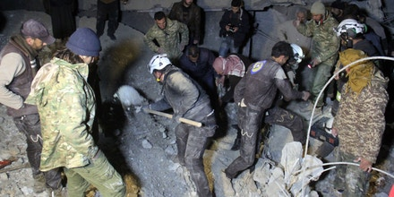 Syrian civil defence volunteers, known as the White Helmets, dig through the rubble of a mosque following a reported airstrike on a mosque in the village of Al-Jineh in Aleppo province late on March 16, 2017.The US military says it carried out an air strike in northern Syria against an Al-Qaeda target, but denies deliberately targeting a mosque where dozens were killed according to the Syrian Observatory for Human Rights. / AFP PHOTO / Omar haj kadour (Photo credit should read OMAR HAJ KADOUR/AFP/Getty Images)