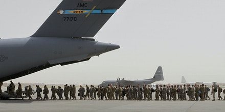 FILE- In this Thursday, July 14, 2011 file photo, U.S. soldiers board a U.S. military aircraft as they leave Afghanistan, at the U.S. base in Bagram, north of Kabul, Afghanistan. U.S. A bill passed by Congress allowing the families of 9/11 victims to sue the Saudi government has reinforced to some in the Arab world a long-held view that the U.S. only demands justice for its own victims of terrorism, despite decades of controversial U.S. interventions around the world. (AP Photo/Musadeq Sadeq, File)