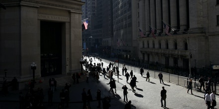People walk freely in front of the New York Stock Exchange in New York, in 2011.