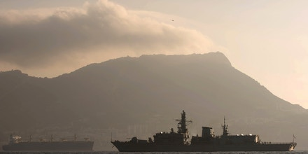 With the rock of Gibraltar in the background, Britain's Royal Navy ship HMS Westminster sails along the Gibraltar stretch near to La Linea de la Concepcion, Spain, Monday, Aug. 19, 2013. The British government said it is considering taking Spain to court if it does not ease border checks on traffic entering the disputed enclave of Gibraltar. Spain has long laid claim to Gibraltar, and the tiny territory on the southern tip of the Iberian peninsula is the source of occasional diplomatic friction between Madrid and London. The latest spat involved an artificial reef being built in Gibraltar that Spain said is hurting its fishermen. It has floated the idea of charging border fees as compensation. U.K. officials.  (AP Photo/Laura Leon)