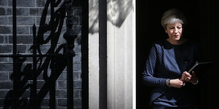 TOPSHOT - British Prime Minister Theresa May walks out of 10 Downing Street to speak to media in central London on April 18, 2017.British Prime Minister Theresa May called today for an early general election on June 8 in a surprise announcement as Britain prepares for delicate negotiations on leaving the European Union. / AFP PHOTO / Daniel LEAL-OLIVAS (Photo credit should read DANIEL LEAL-OLIVAS/AFP/Getty Images)