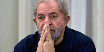 Former Brazilian President (2003-2011) Luiz Inacio Lula da Silva gestures during a meeting with the Workers' Party (PT) members in Sao Paulo, Brazil on March 30, 2015 AFP PHOTO / Nelson ALMEIDA        (Photo credit should read NELSON ALMEIDA/AFP/Getty Images)