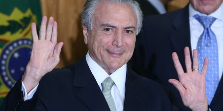BRASILIA, BRAZIL - MAY 12:  Brazil's interim President Michel Temer waves at a signing ceremony for new government ministers at the Planalto presidential palace after the Senate voted to accept impeachment charges against suspended President Dilma Rousseff on May 12, 2016 in Brasilia, Brazil. Rousseff has been suspended from her presidential duties and will face a Senate trial for alleged manipulation of government accounts.  (Photo by Mario Tama/Getty Images)