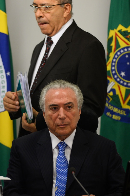 Brazilian President Michel Temer (front) and his Chief of Staff Eliseu Padilha attend a meeting with the infrastructure nucleus of the government at the Planalto Palace, in Brasilia, December 11, 2017.  / AFP / ANDRESSA ANHOLETE        (Photo credit should read ANDRESSA ANHOLETE/AFP/Getty Images)