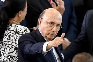 Brazilian Finance Minister Henrique Meirelles gives the thumb up during the swearing in ceremony of Brazilian new Minister of Justice Osmar Serraglio and new Minister of Foreign Affairs Aloysio Nunes Ferreira (out of frame) at Planalto Palace in Brasilia, on March 7, 2017.Serraglio replaces Alexandre de Moraes, who was appointed for the Supreme Court, and Nunes replaces Jose Serra, who stepped down citing health concerns. / AFP PHOTO / EVARISTO SA (Photo credit should read EVARISTO SA/AFP/Getty Images)
