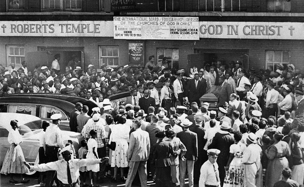 A large crowd gathers outside the Roberts Temple Church of God In Christ in Chicago, Ill.,  Sept. 6, 1955 as pallbearers carry the casket of Emmett Till, a 14-year-old African-American boy who was slain while on a visit to Mississippi. Police estimate a crowd of about 2,000.  (AP Photo)