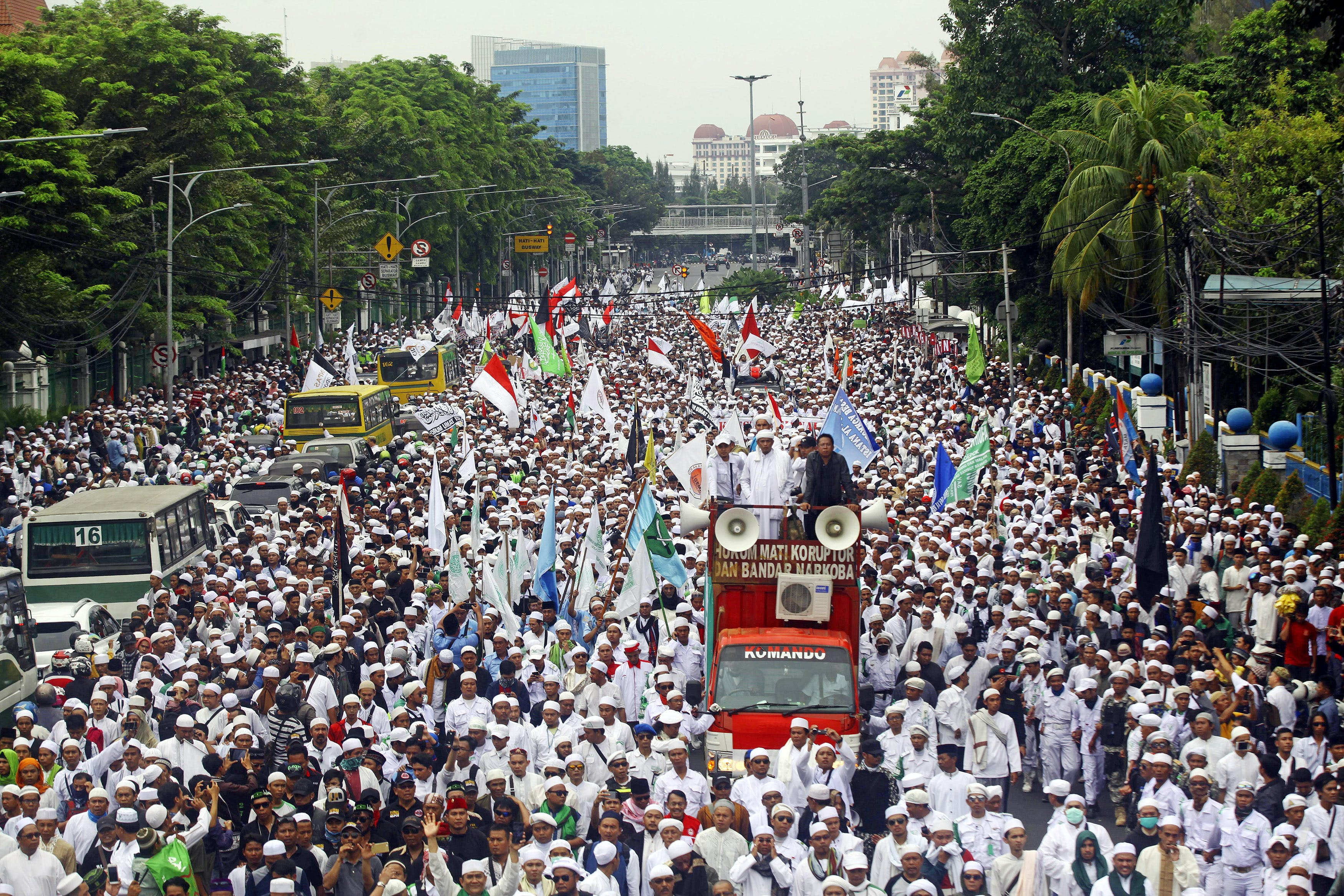 "JAKARTA, INDONESIA - OCTOBER 14 : Thousands of the hardline Islamic Defenders Front (FPI) member take part in a protest in Jakarta, Indonesia, on October 14, 2016 to show their disapproval for Governor Basuki Tjahaja Purnama, better known by his nickname ""Ahok"", after the governors controversial purportedly anti-Islamic speech. Although Jakarta governor Ahok was quoted out of context giving a speech that was interpreted by hardliners as anti-Islamic and blasphemy in Jakarta earlier this month, the Islamic Defenders Front (FPI) group are staging a large protest to show their disdain for the politician. (Photo by Agoes Rudianto/Anadolu Agency/Getty Images)"