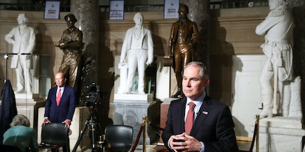 WASHINGTON, DC - FEBRUARY 28: Commerce Secretary Wilbur Ross (L), and EPA Administrator Scott Pruitt (R) prepare to do television interviews in Statuary Hall at the U.S. Capitol before President Donald Trump delivers a speech to a joint session of Congress on February 28, 2017 in Washington, DC. Trump's first address to Congress is expected to focus on national security, tax and regulatory reform, the economy, and healthcare.  (Photo by Mark Wilson/Getty Images)