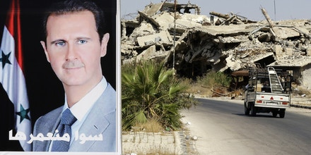 A vehicle drives past a poster of Syrian President Bashar al-Assad and destroyed buildings in the government held Jouret al-Shiah neighbourhood of the central Syrian city of Homs on September 19, 2016. / AFP / LOUAI BESHARA (Photo credit should read LOUAI BESHARA/AFP/Getty Images)