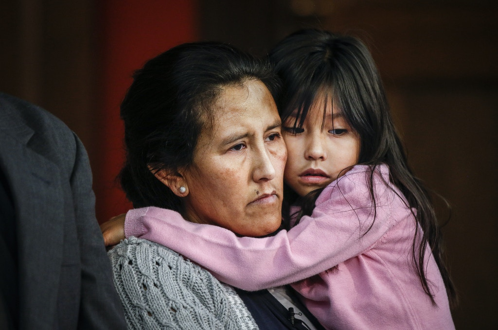 DENVER, CO - FEBRUARY 15: Undocumented immigrant and activist Jeanette Vizguerra, 45, hugs her youngest child Zury Baez, 6, while addressing supporters and the media as she seeks sanctuary at First Unitarian Church on February 15, 2017 in Denver, Colorado. Vizguerra, who has been working the United States for some 20 years, and her children will be living in a room in the basement of the church hoping to avoid deportation after the local office of Immigration and Customs Enforcement denied a stay of her case which would lead to her immediate deportation. (Photo by Marc Piscotty/Getty Images)