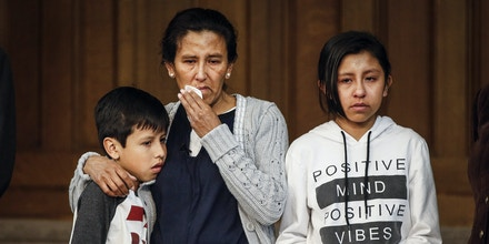 DENVER, CO - FEBRUARY 15: Undocumented immigrant and activist Jeanette Vizguerra, 45, stands with her children Roberto, 10, and Luna Baez, 12, as she addresses supporters and the media while seeking sanctuary at First Unitarian Church on February 15, 2017 in Denver, Colorado. Vizguerra, who has been working the United States for some 20 years, and her children will be living in a room in the basement of the church hoping to avoid deportation after the local office of Immigration and Customs Enforcement denied a stay of her case which would lead to her immediate deportation. (Photo by Marc Piscotty/Getty Images)