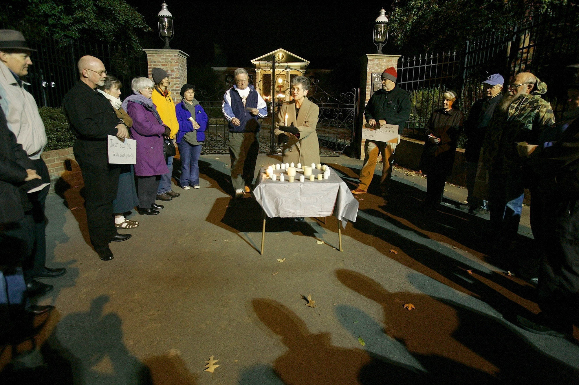 More than 30 death penalty protestors gather in front of the Arkansas Governor's Mansion as Arkansas Coalition to Abolish the Death Penalty board member Freddie Nixon, center, prepares to light candles late Monday, Nov. 28, 2005, in Little Rock, Ark. The group met to protest the scheduled execution of condemned killer Eric Nance. The U.S. Supreme Court delayed the scheduled execution of condemned killer Eric Nance to give Justice Clarence Thomas more time to review the case. (AP Photo/Danny Johnston)