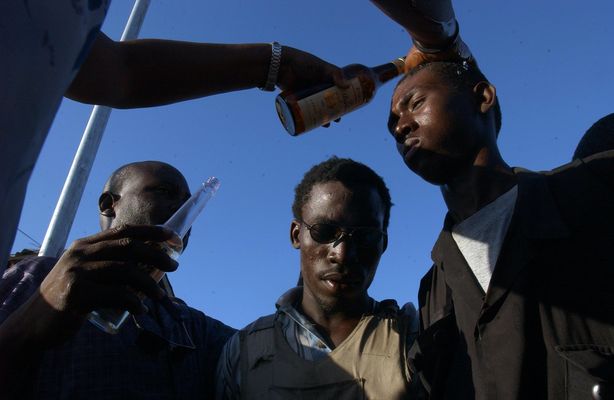 A rebel is blessed during a Voodoo ceremony of the Gonaives Resistance Front, during a march in Gonaives, Haiti, Friday, Feb. 13, 2004, in honor of a former leader of the group, Amoit Metayer who was killed last Sept. 21. The Gonaives Resistance Front used to be allied with Aristide, but turned against the Haitian President last year. (AP Photo/WalterAstrada)