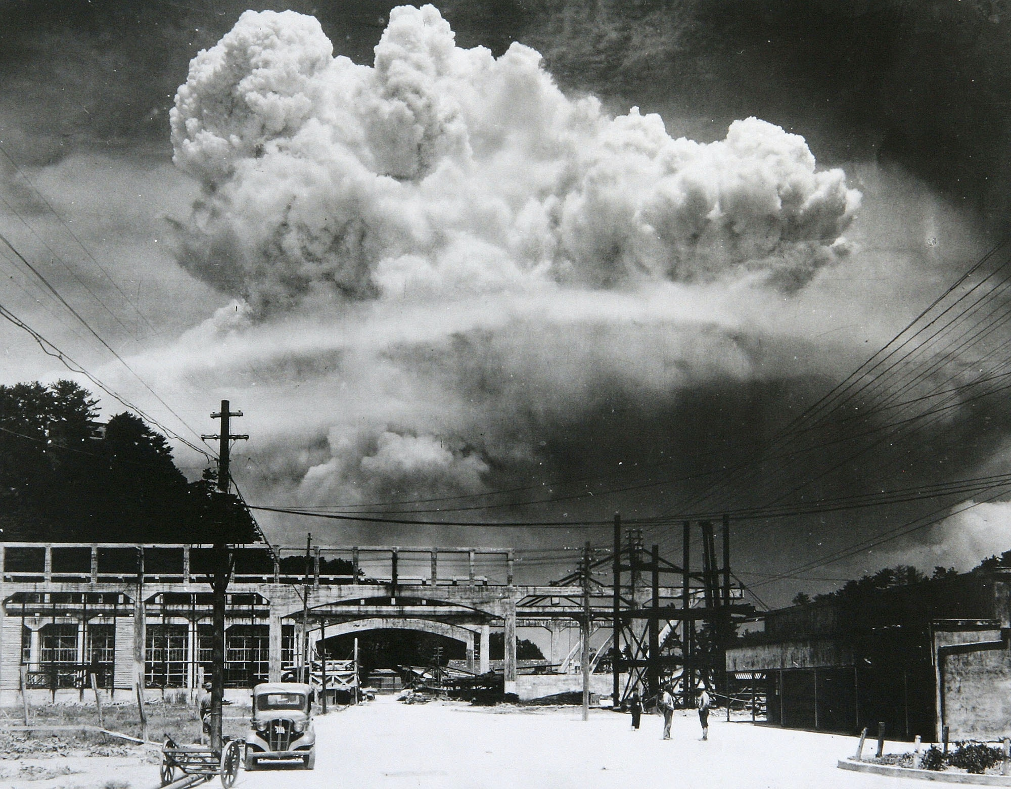 View of the radioactive plume from the bomb dropped on Nagasaki City, as seen from 9.6 km away, in Koyagi-jima, Japan, August 9, 1945. The US B-29 superfortress Bockscar dropped the atomic bomb nicknamed 'Fat Man,' which detonated above the ground, on northern part of Nagasaki City just after 11am. (Photo by Hiromichi Matsuda/Handout from Nagasaki Atomic Bomb Museum/Getty Images)