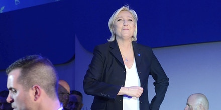 Far-right National Front leader Marine Le Pen addresses activists at the Espace Francois Mitterrand on April 23, 2017, in Henin-Beaumont, north of France. Le Pen will face centrist leader Emmanuel Macron in a run-off for the French presidency on 7 May, near-final results show. With 96% of votes counted from Sunday's first round, Mr Macron has 23.9% with Ms Le Pen on 21.4%. Photo by Aurore Marechal/Sipa USA(Sipa via AP Images)
