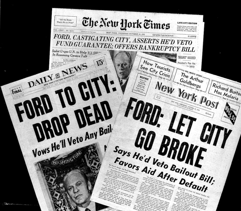 Two New York City dailies and the New York Times are seen with headlines on President Ford's refusal to aid the city during its fiscal crisis, Oct. 30, 1975.  (AP Photo)