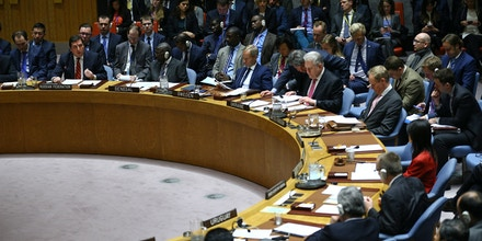 NEW YORK, USA - APRIL 7: Russia's Deputy Permanent Representative to the UN Vladimir Safronkov (2nd L) speaks during a meeting of the United Nations Security Council at UN headquarters, April 7, 2017 in New York, United States. On Thursday night, the United States launched airstrikes directed at Syrian government air bases in response to the chemical attack earlier in the week. (Photo by Volkan Furuncu/Anadolu Agency/Getty Images)