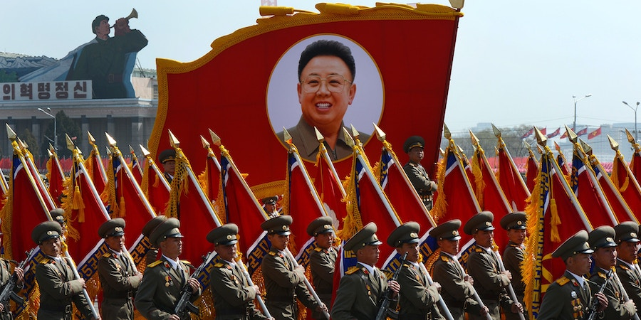 North Korean soldiers carry a portrait of late leader Kim Jong-Il during a military parade to mark 100 years since the birth of the country's founder Kim Il-Sung in Pyongyang on April 15, 2012. The commemorations came just two days after a satellite launch timed to mark the centenary fizzled out embarrassingly when the rocket apparently exploded within minutes of blastoff and plunged into the sea.    AFP PHOTO / PEDRO UGARTE (Photo credit should read PEDRO UGARTE/AFP/Getty Images)