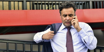 Brazilian senator Aecio Neves speaks on his mobile phone upon arrival at the Maiquetia international airport in Caracas on June 18, 2015. Brazilian senators arrived in Venezuela to look up the situation of imprisoned dissidents on hunger strike, but failed to do so and flew back to Brazil. AFP PHOTO/CARLOS BECERRA        (Photo credit should read CARLOS BECERRA/AFP/Getty Images)