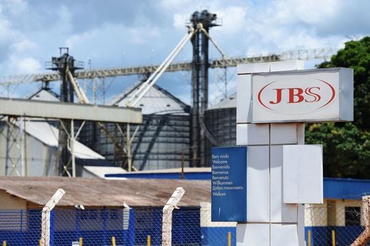 "View of the JBS-Friboi Logo at the chicken processing plant entrance, in Samambaia, Federal District, Brazil on March 17, 2017.<br /> Brazilian Federal police have dismantled, after two years of running the ""weak flesh"" operation, a vast network of adulterated food, involving major meat processing plants and inspectors who accepted bribes to approve products in bad condition for domestic consumption and exportation.  / AFP PHOTO / EVARISTO SA        (Photo credit should read EVARISTO SA/AFP/Getty Images)"