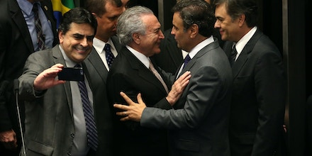 (160831) -- BRASILIA, Aug. 31, 2016 (Xinhua) -- Michel Temer (C) greets with senator Aecio Neves following his swear-in ceremony as President of Brazil in Brasilia, Brazil, Aug. 31, 2016. Temer was sworn in as the new president of Brazil on Wednesday afternoon, after Dilma Rousseff was stripped of the presidency by the Senate in an impeachment trial. (Xinhua/Li Ming) (wr) (Photo by Xinhua/Sipa USA)