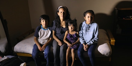 DENVER, CO - MAY 05:  Jeanette Vizguerra, 45, sits with her U.S.-born children, Roberto, 10, Zury, 6, and Luna, 12 while taking sanctuary at the First Baptist Church on May 5, 2017 in Denver, Colorado. Her children stay with her at the church on weekends. Vizguerra, who has lived in the U.S. for 20 years, took refuge almost three months ago, avoiding a check-in meeting with U.S. Customs and Border Enforcement (ICE), where her stay of deportation was declined. Vizguerra has become a leader in the new sanctuary movement, where churches nationwide are housing undocumented immigrants to shield them from deportation. In April Time Magazine named her as one of the 100 most influential people in the United States. Vizguerra came from Mexico as an undocumented immigrant in 1997, working as a janitor and owning a cleaning service while working as a union organizer and immigrant rights activist. She pled to a misdemeanor in 2009 after being caught with forged documents she obtained to get employment. (Photo by John Moore/Getty Images)