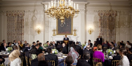 President Barack Obama stands at the podium and speaks as he hosts an Iftar dinner celebrating Ramadan in the State Dining Room of the White House, Thursday, July 25, 2013, in Washington. (AP Photo/Carolyn Kaster)