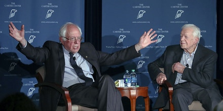 Former President Jimmy Carter, right, and Sen. Bernie Sanders discuss human rights during the Human Rights Defenders Forum at the Carter Center in Atlanta on Monday, May 8, 2017. (Curtis Compton/Atlanta Journal-Constitution via AP)
