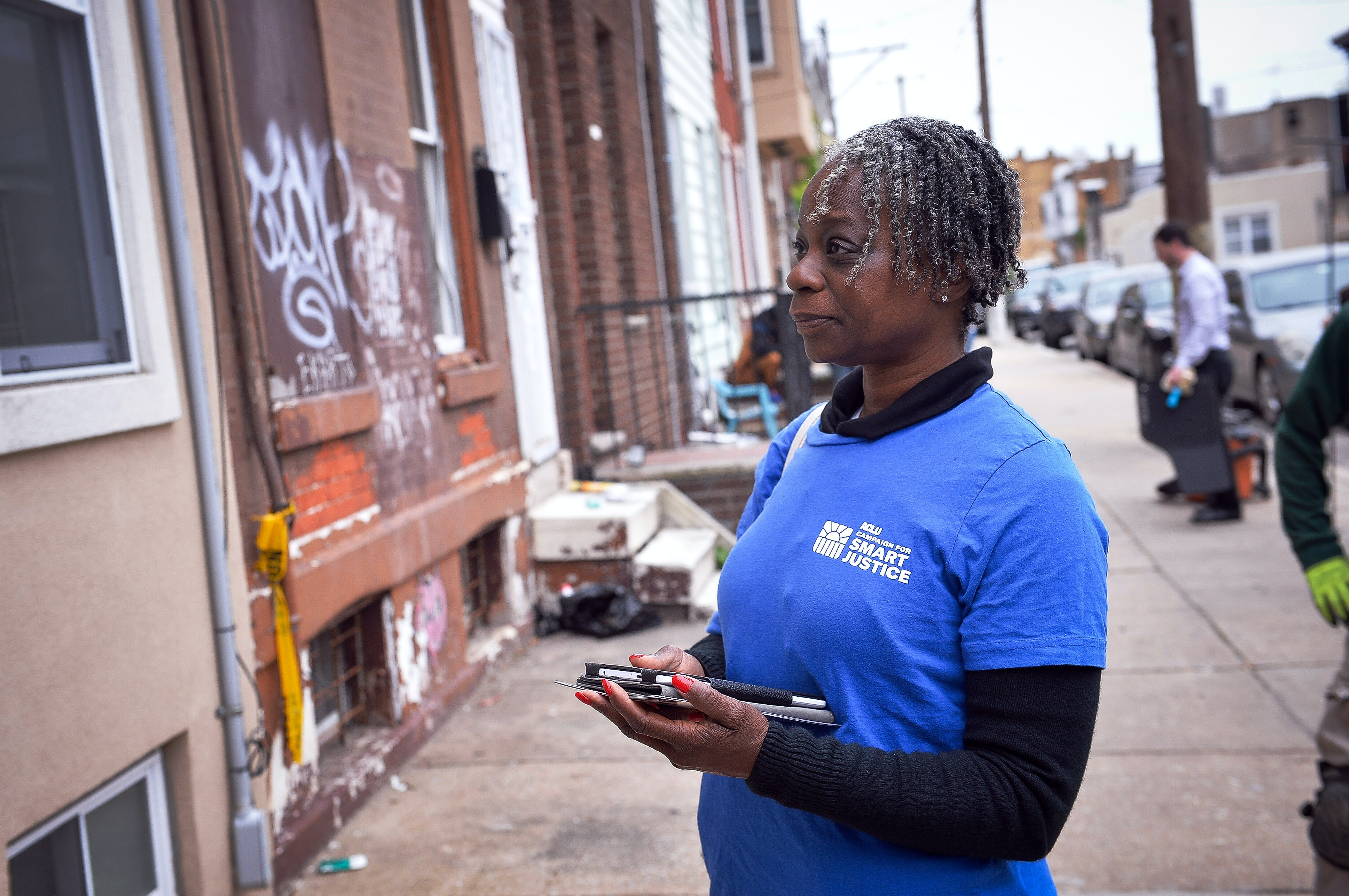 Donna Carter waits to see if a resident as home as she canvasses on behalf of the ACLU in South Philadelphia, PA,Thursday, May 11, 2017.Charles Mostoller for the Intercept