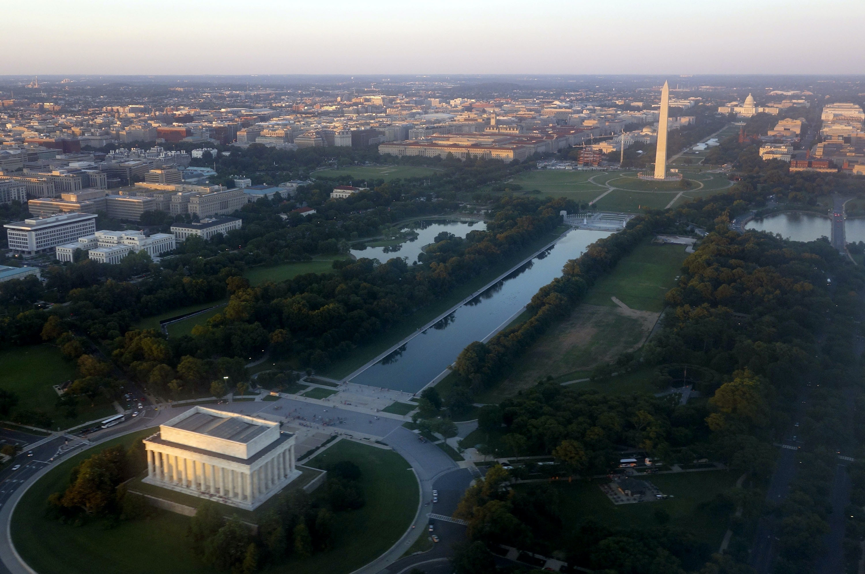 The skyline of Washington, DC, including the Lincoln Memorial, Washington Monument, US Capitol and National Mall, is seen from the air at sunset in this photograph taken on June 15, 2014. AFP PHOTO / Saul LOEB        (Photo credit should read SAUL LOEB/AFP/Getty Images)