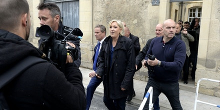 French presidential election candidate for the far-right Front National (FN) party Marine Le Pen leaves the Cathedral of Reims through a backdoor on May 5, 2017.  / AFP PHOTO / FRANCOIS NASCIMBENI        (Photo credit should read FRANCOIS NASCIMBENI/AFP/Getty Images)