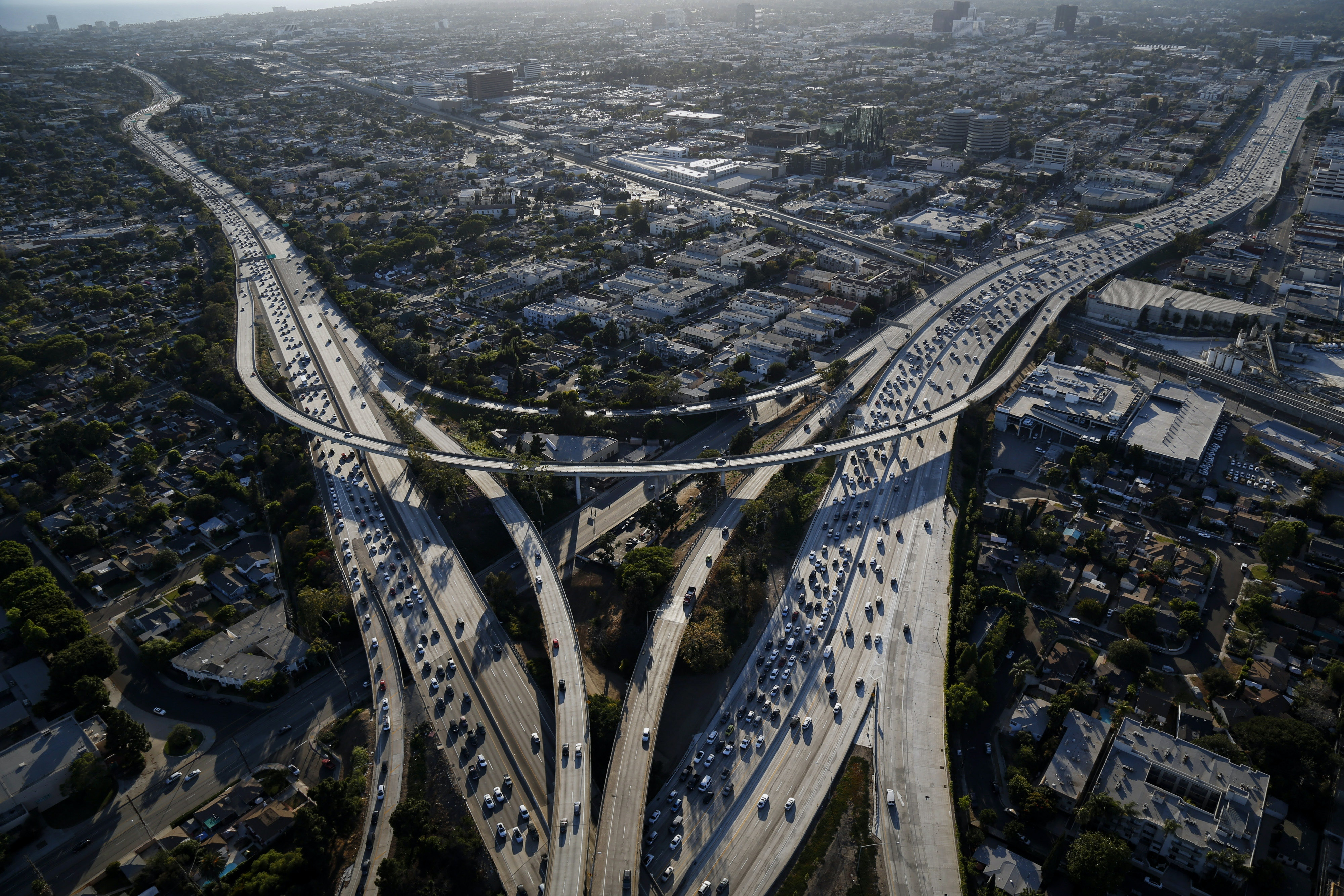 Vehicles sit in rush hour traffic between the Interstate 405 and 10 freeways in this aerial photograph taken over Los Angeles, California, U.S., on Friday, July 10, 2015. The greater Los Angeles region routinely tops the list for annual traffic statistics of metropolitan areas for such measures as total congestion delays and congestion delays per peak-period traveler. Photographer: Patrick T. Fallon/Bloomberg via Getty Images
