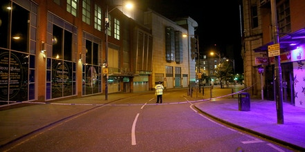 MANCHESTER, ENGLAND - MAY 23:  A police officer guards the scene near Manchester Arena on May 23, 2017 in Manchester, England.  An explosion occurred at Manchester Arena as concert goers were leaving the venue after Ariana Grande had performed.  Greater Manchester Police have confirmed 19 fatalities and at least 50 injured. (Photo by Christopher Furlong/Getty Images)