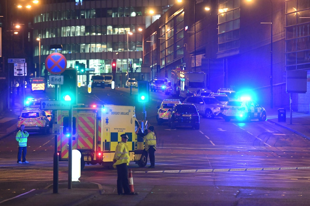 TOPSHOT - Emergency response vehicles are parked at the scene of a suspected terrorist attack during a pop concert by US star Ariana Grande in Manchester, northwest England on May 23, 2017. / AFP PHOTO / Paul ELLIS        (Photo credit should read PAUL ELLIS/AFP/Getty Images)