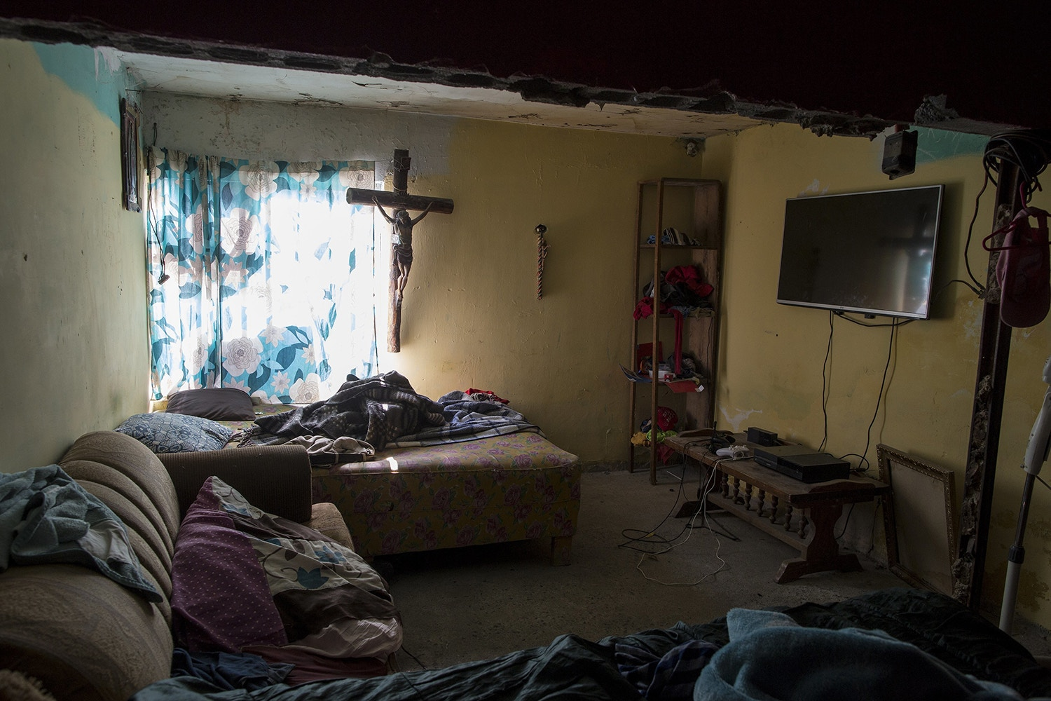 The home of Jesus Esteban Cruz in Reynosa, Mexico, Wednesday, March 22, 2017, across the border from McAllen, Texas. Cruz's 20-yar-old daughter Paula says she's going to write a book someday about her single mother who moved to Reynosa and raised three kids who stayed out of trouble despite the turmoil that swirled around them. (AP Photo/Rodrigo Abd)
