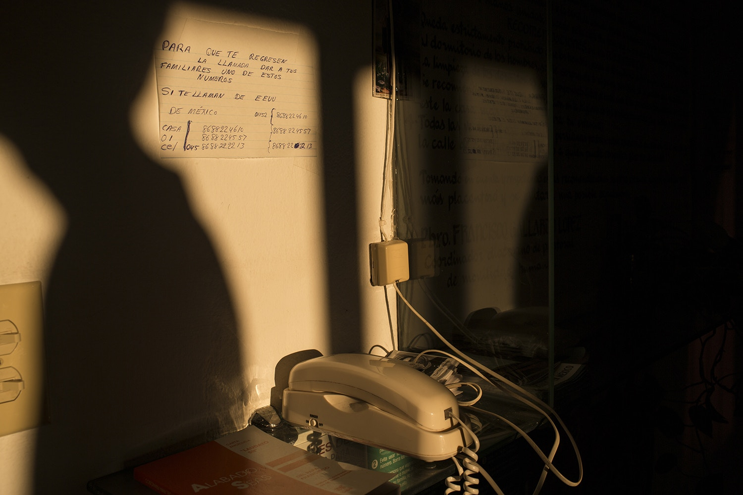 "A phone used by migrants to call their families sits in the ""Casa del Migrante"" migrant shelter in Matamoros, Tamaulipas state, Mexico, Wednesday, March 22, 2017, across the border from Brownsville, Texas. (AP Photo/Rodrigo Abd)"