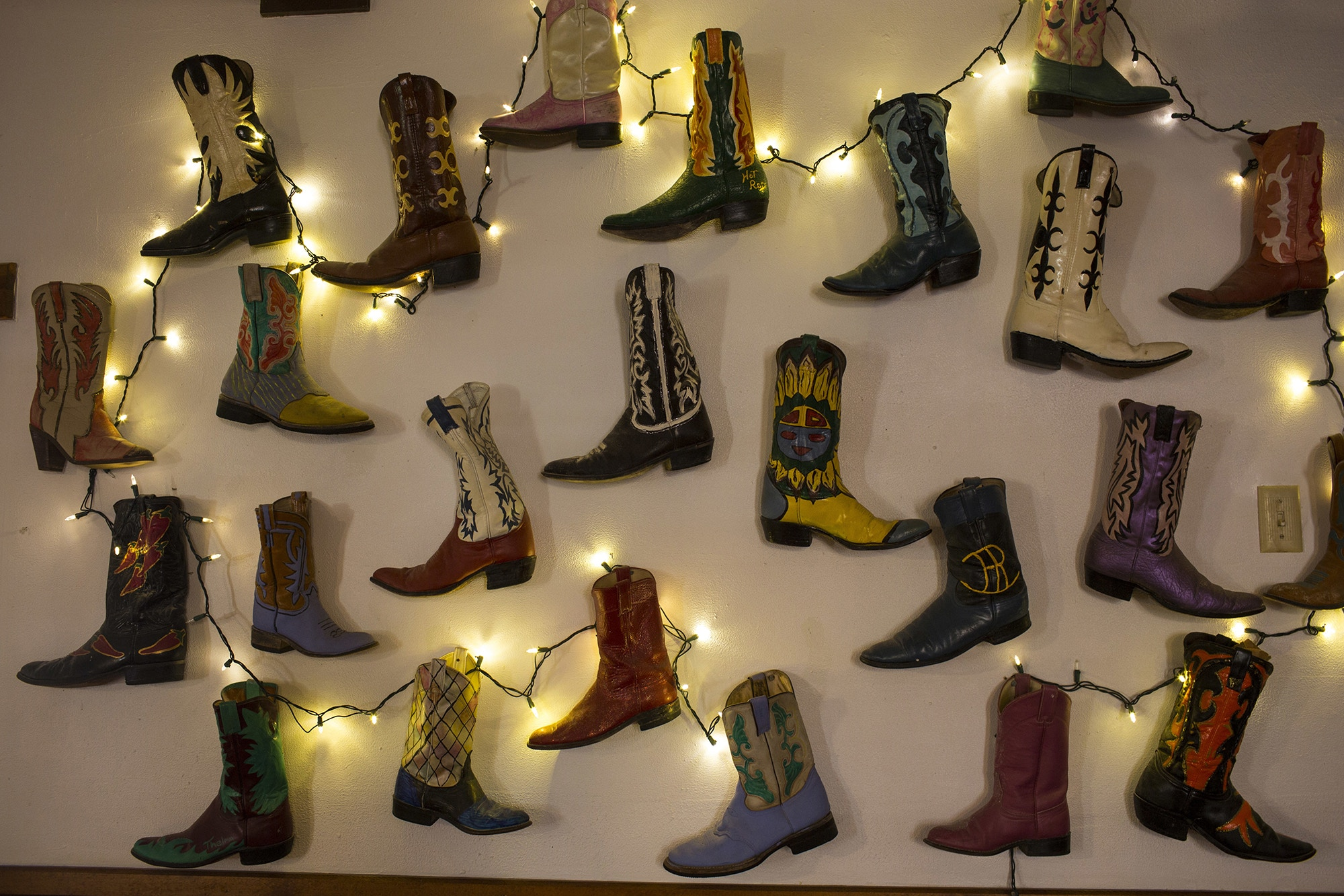 Boots decorate a wall at the Bad Rabbit Cafe in Terlingua, Texas, near the US-Mexico border, Monday, March 27, 2017. (AP Photo/Rodrigo Abd)