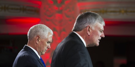 Franklin Graham, right, prays for Vice President Mike Pence during the World Summit in Defense of Persecuted Christians hosted by Graham, and the Billy Graham Evangelistic Association, Thursday, May 11, 2017, in Washington. (AP Photo/Cliff Owen)