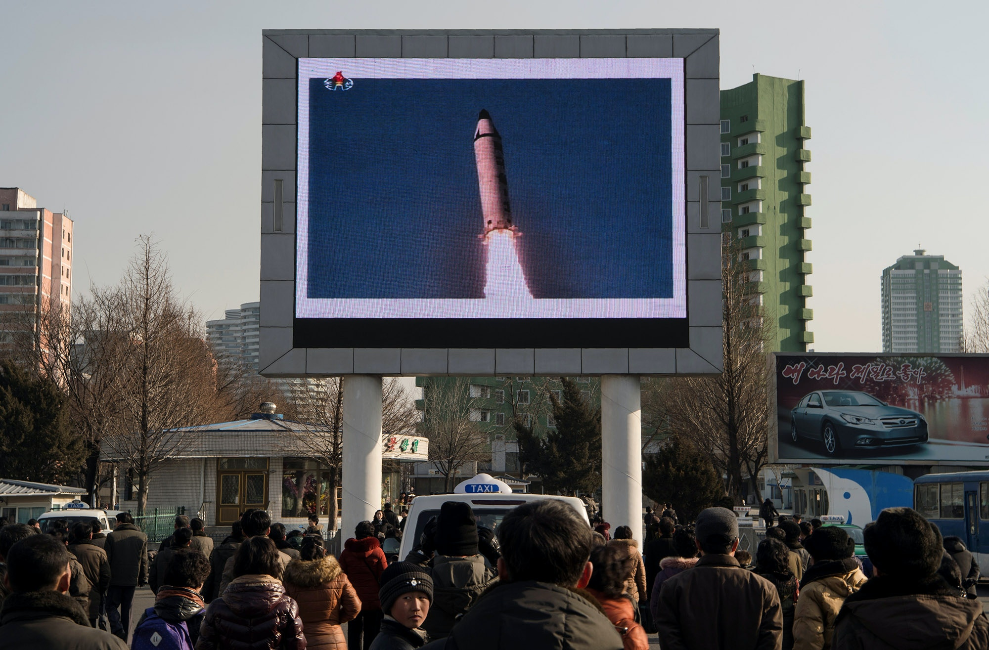 This photo taken on February 13, 2017 shows people in Pyongyang watching a public broadcast about the launch of a surface-to-surface medium long-range ballistic missile Pukguksong-2 at an undisclosed location on February 12.<br /><br /><br /> The UN Security Council on February 13 unanimously condemned North Korea's latest ballistic missile test as US President Donald Trump vowed to deliver a strong response to the provocation. / AFP / KIM Won-Jin        (Photo credit should read KIM WON-JIN/AFP/Getty Images)