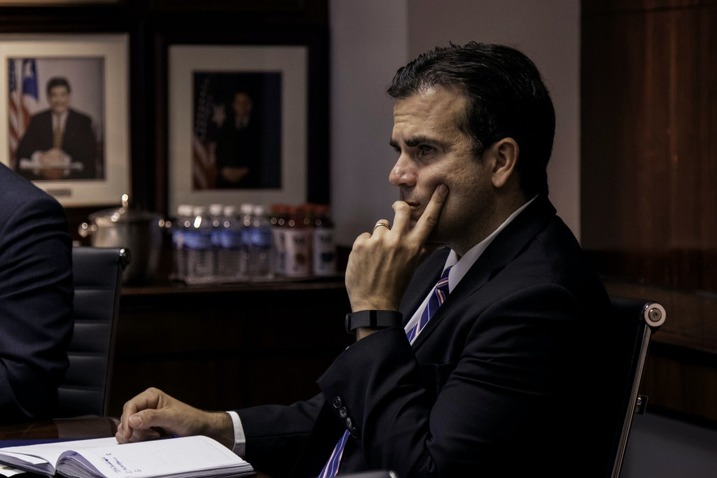 Ricardo Rossello, governor of Puerto Rico, listens during a meeting at Puerto Rico Industrial Development Company (PRIDCO) headquarters in San Juan, Puerto Rico, U.S., on Tuesday, March 28, 2017. Puerto Rico's economy has been contracting for a decade. Last year, almost 65,000 residents left the island, keeping pace with the previous two years, when the exodus reached the worst since at least the 1980s. Photographer: Alejandro Granadillo/Bloomberg via Getty Images