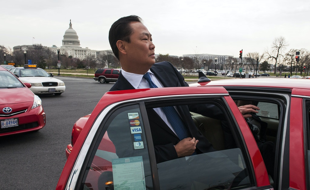 With the Capitol in the background, Stephen Kim, a former State Department expert on North Korea, gets into a cab as he leaves federal court in Washington, Wednesday, April 2, 2014, after a federal judge sentenced him to 13 months in prison for passing classified information to a journalist.  (AP Photo/Cliff Owen)