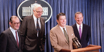 U.S. President Ronald Reagan announces the appointment of Alan Greenspan, left, as his choice to replace Paul Volcker, center, as chairman of the Federal Reserve Board at a White House briefing on June 2, 1987.  The man at right is Secretary of Treasury James A. Baker III.  (AP Photo/Barry Thumma)